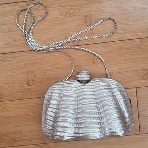 Rare silver tone evening clamshell bag by J Tiras